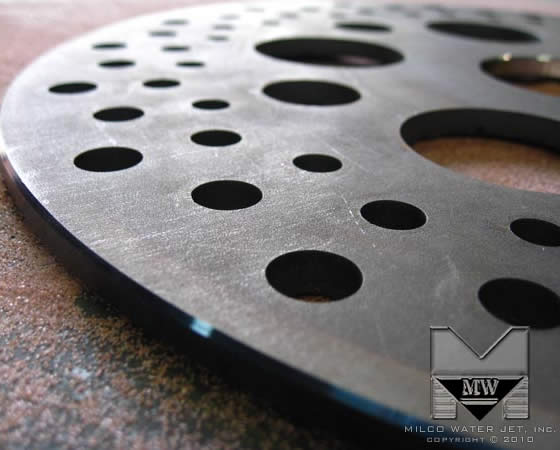 Water Jet cut of Titanium Disk Brake Rotor for Racing and Performance by MILCO Waterjet, in Orange County, Southern California
